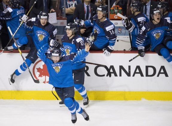 Finland bench celebrates gold