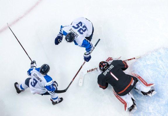 Team Canada Michael DiPietro Team Finland's Toni Utunen and Aarne Talvitie