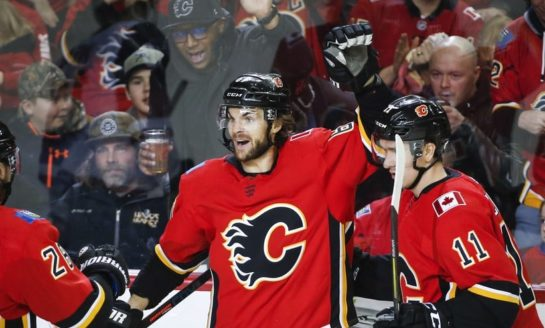 Flames Burn Coyotes - Giordano Leads With 2 Points