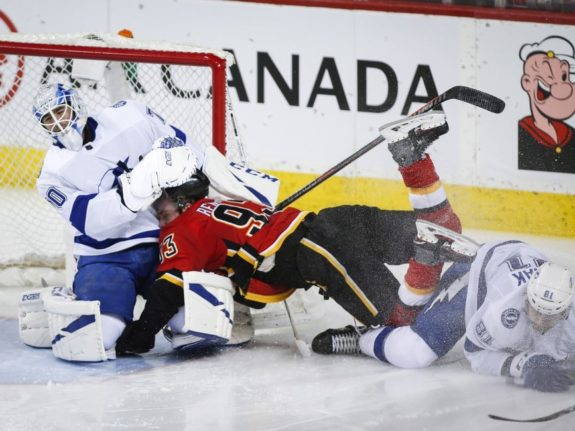 Tampa Bay Lightning's Erik Cernak Calgary Flames' Sam Bennett Louis Domingue