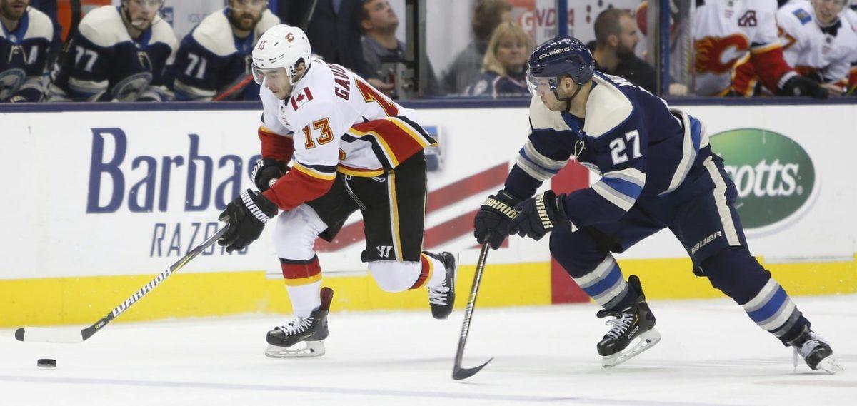 Calgary Flames' Johnny Gaudreau and Columbus Blue Jackets' Ryan Murray