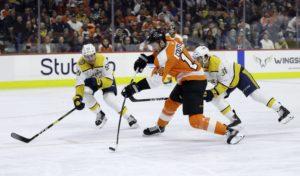 Philadelphia Flyers' Sean Couturier Nashville Predators' Ryan Hartman Roman Josi