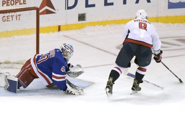 Washington Capitals Alex Ovechkin skates in against New York Rangers Alexandar Georgiev