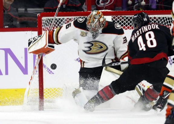 Carolina Hurricanes' Jordan Martinook has his shot blocked by Anaheim Ducks goaltender John Gibson
