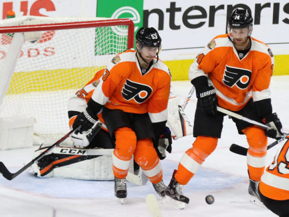 Shayne Gostisbehere and Sean Couturier (Amy Irvin / The Hockey Writers)