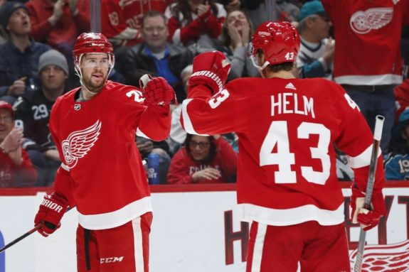 Detroit Red Wings players Mike Green and Darren Helm