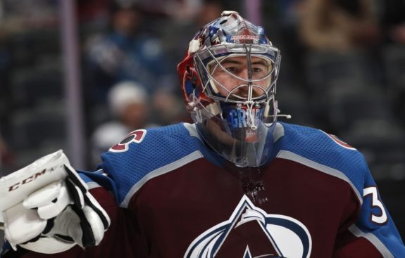 MacKinnon has two points, Avalanche hold off Blues