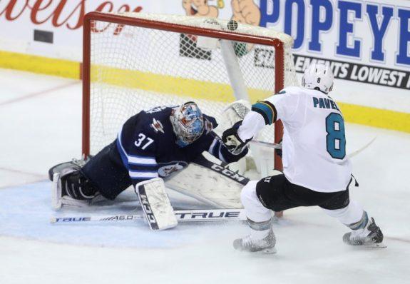 San Jose Sharks' Joe Pavelski Winnipeg Jets Connor Hellebuyck