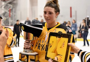 Hilary Knight of the Boston Pride holds the Isobel Cup and Denna Laing's no. 24. (Photo Credit: Troy Parla)
