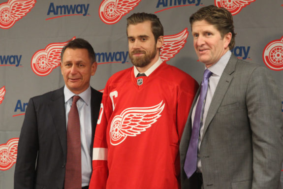 Ken Holland, Henrik Zetterberg and coach Mike Babcock.