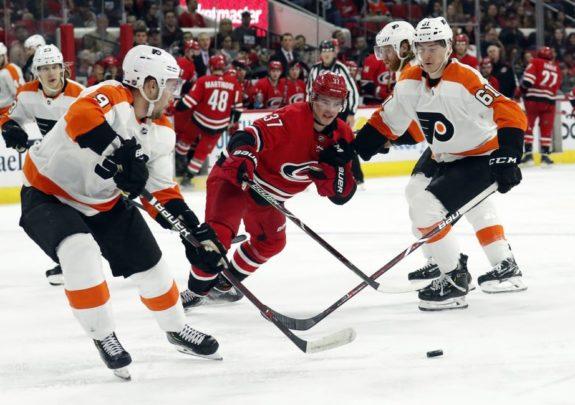 Philadelphia Flyers' Ivan Provorov Philippe Myers Carolina Hurricanes' Andrei Svechnikov
