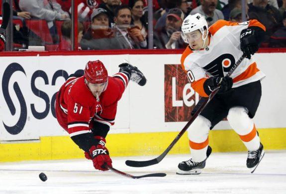 Carolina Hurricanes' Trevor van Riemsdyk Philadelphia Flyers' Jordan Weal