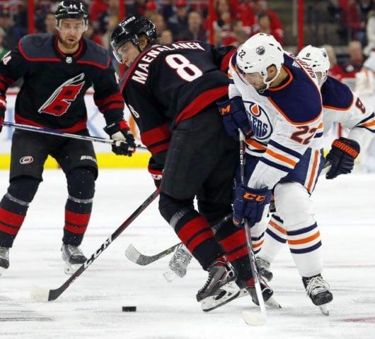 Carolina Hurricanes' Saku Maenalanen Edmonton Oilers' Tobias Rieder