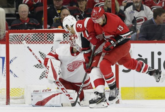 Detroit Red Wings' Nick Jensen and Jonathan Bernier and Carolina Hurricanes' Warren Foegele