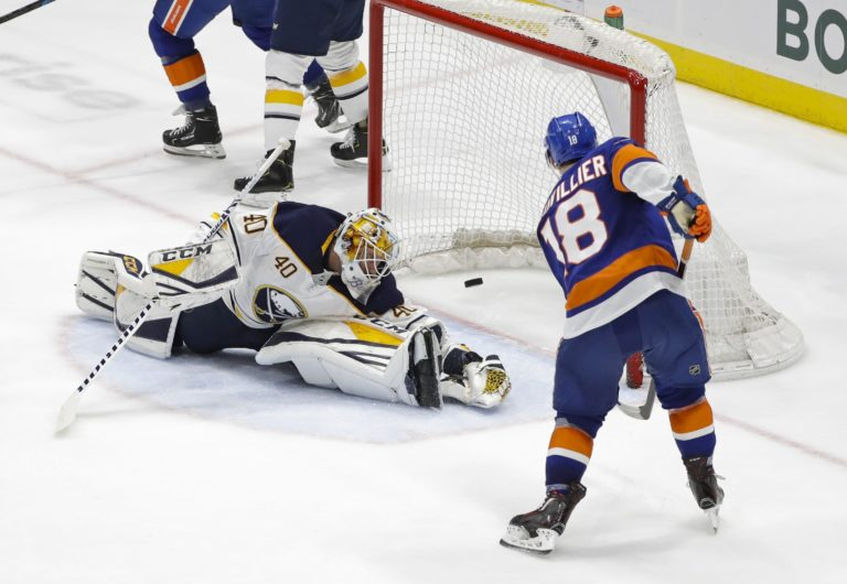 New York Islanders' Anthony Beauvillier Buffalo Sabres' Carter Hutton