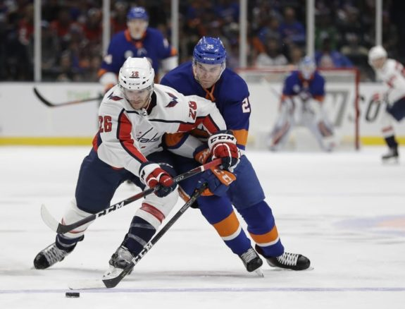 Washington Capitals' Nic Dowd New York Islanders' Devon Toews