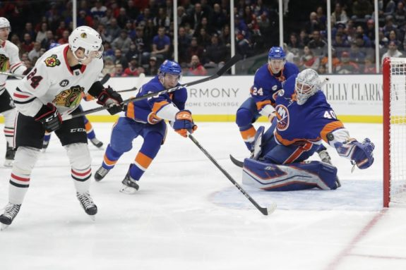 Chicago Blackhawks' Dominik Kahun New York Islanders Robin Lehner