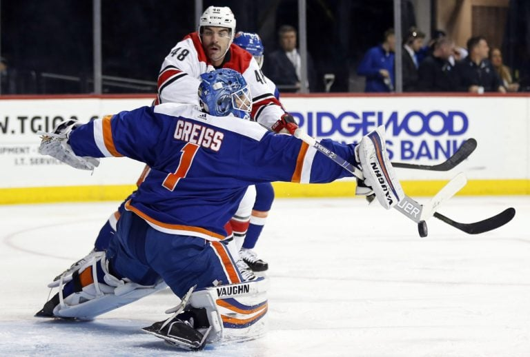 New York Islanders Thomas Greiss Carolina Hurricanes Jordan Martinook