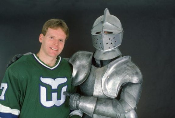 Canadian hockey player Doug Jarvis of the Hartford Whalers poses with an  unidentified person in full body armor cf189fc8c