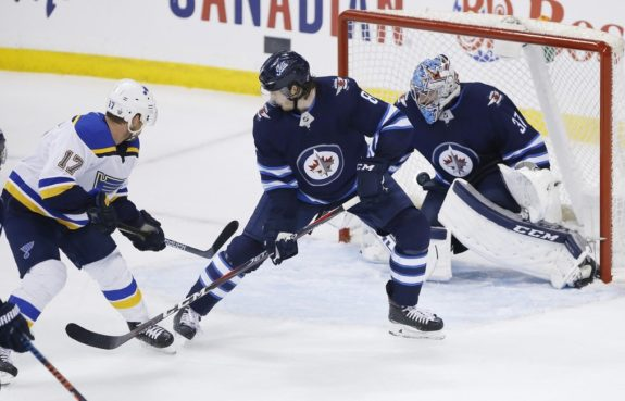 St. Louis Blues' Jaden Schwartz Winnipeg Jets Connor Hellebuyck Jacob Trouba