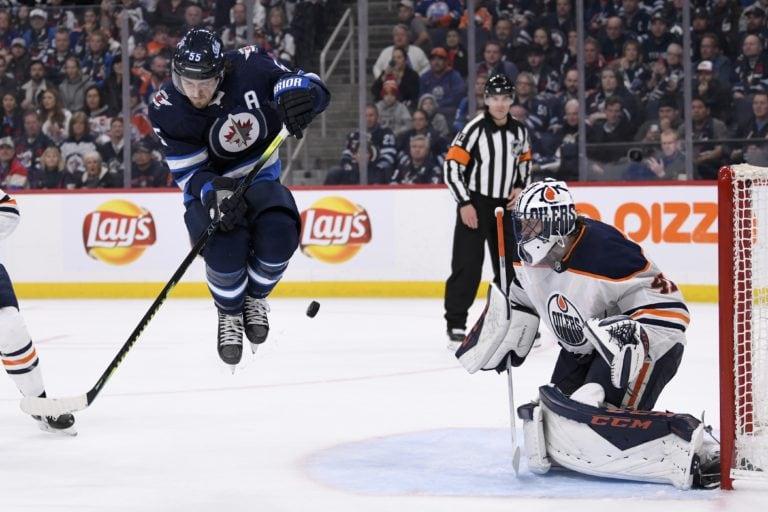 Winnipeg Jets' Mark Scheifele Edmonton Oilers' Mike Smith