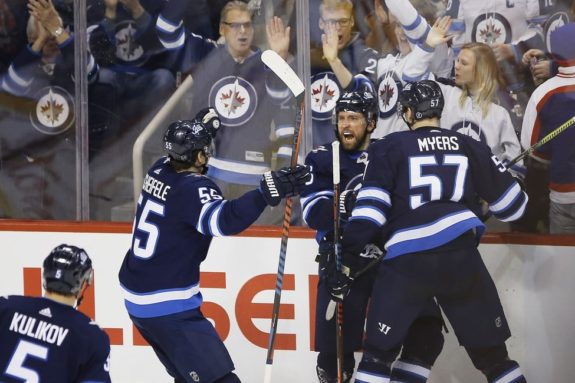 Winnipeg Jets' Blake Wheeler Tyler Myers Mark Scheifele