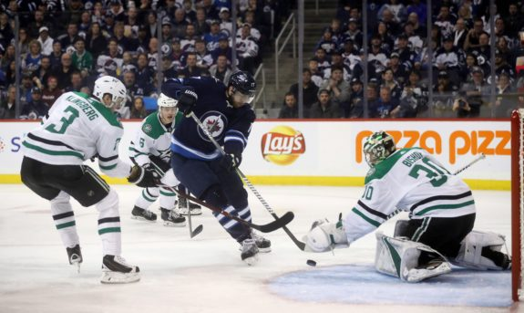 Winnipeg Jets' Adam Lowry Dallas Stars Ben Bishop