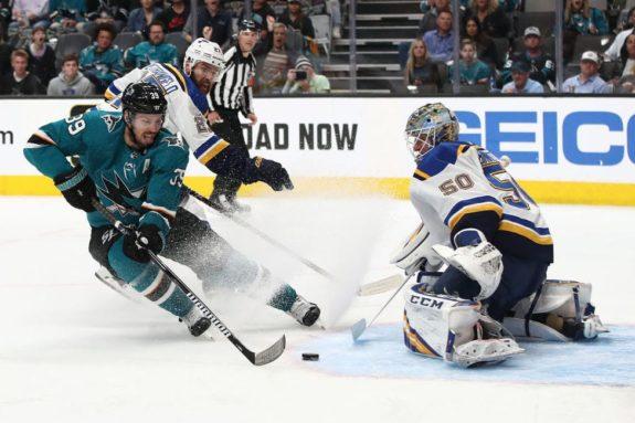 Logan Couture of the San Jose Sharks scores a goal against Jordan Binnington of the St. Louis Blues
