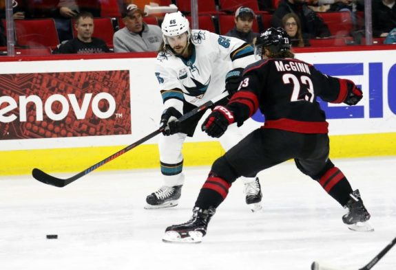 San Jose Sharks' Erik Karlsson Carolina Hurricanes' Brock McGinn.