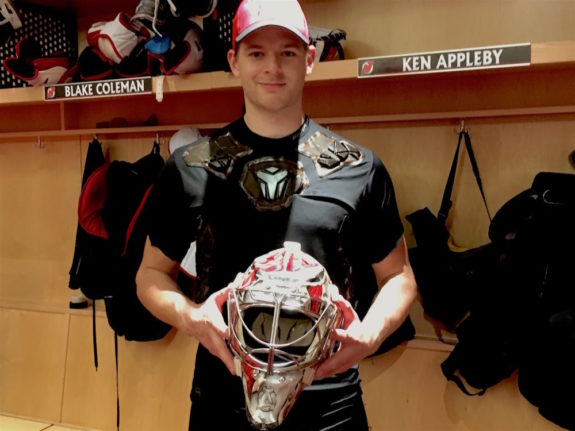 Ken Appleby poses with his mask after Devils Development Camp (Dan Rice/THW)
