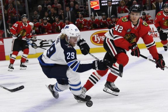 Winnipeg Jets Patrik Laine Chicago Blackhawks Gustav Forsling