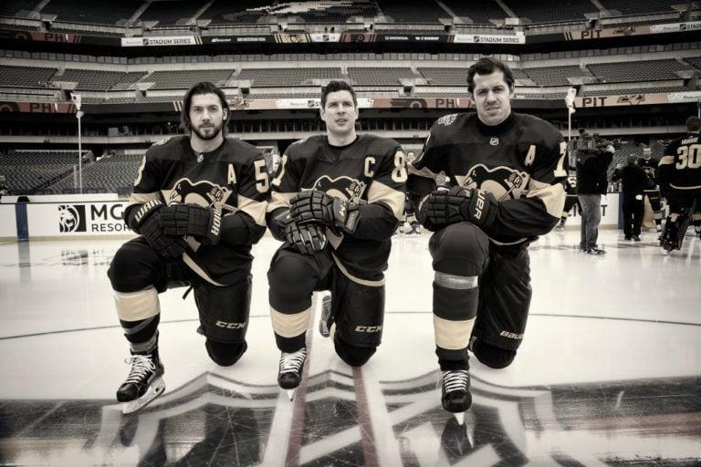 Kris Letang #58, Sidney Crosby #87 and Evgeni Malkin #71