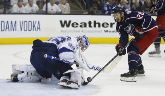 Tampa Bay Lightning's Andrei Vasilevskiy Columbus Blue Jackets' Oliver Bjorkstrand