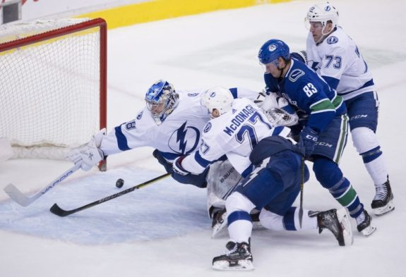 Tampa Bay Lightning Andrei Vasilevskiy tries to stop Vancouver Canucks Christopher Tanev