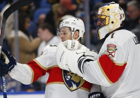 Florida Panthers Evgenii Dadonov and Roberto Luongo