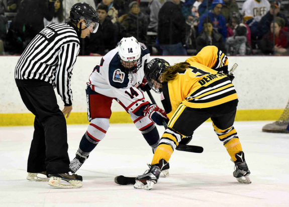 Madison Packer of the New York Riveters takes a face-off against Jillian Dempsey of the Boston Pride. (Photo Credit: Troy Parla)