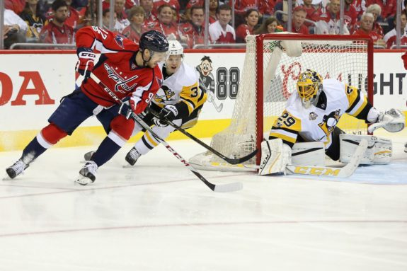 Olli Maatta defending against Washington's Evgeny Kuznetsov