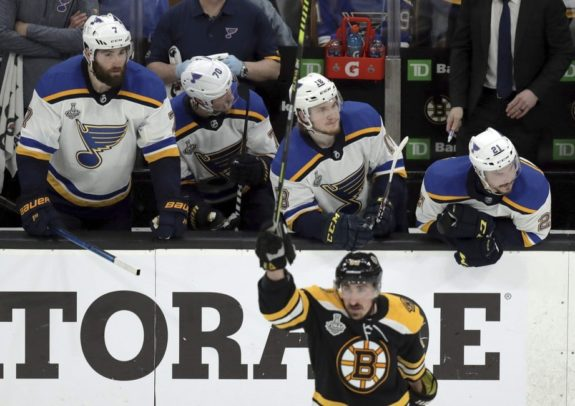 St. Louis Blues players on the bench Boston Bruins' Brad Marchand