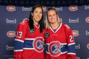 Caroline Ouellette and Marie-Philip Poulin show off the new jerseys of Les Canadiennes de Montreal. (courtesy of CWHL)