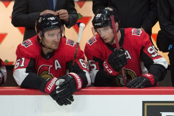 Mark Stone speaks with center Matt Duchene