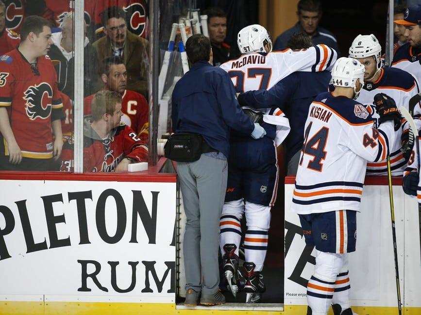 Edmonton Oilers' Connor McDavid is helped off the ice