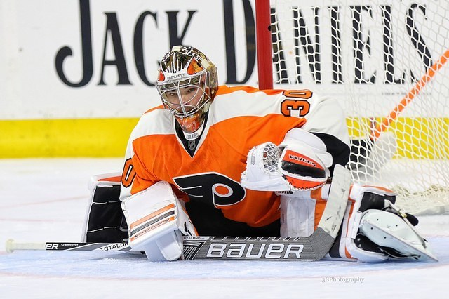 (Amy Irvin/The Hockey Writers) Philadelphia Flyers goaltender Michal Neuvirth is leading the NHL in save percentage at .937 through 17 appearances and 960 minutes of action this season, but is he the starter or the backup going forward?