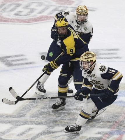 Notre Dame's Jake Evans Michigan's Josh Norris