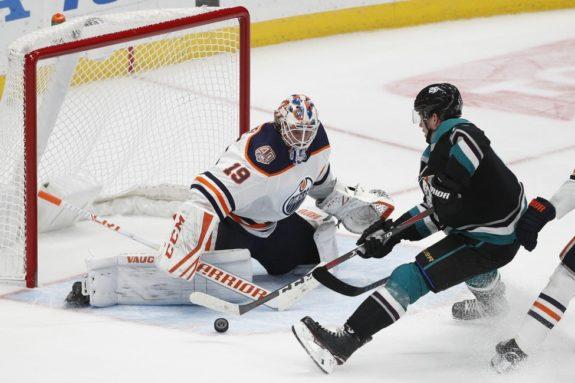Rickard Rakell, Mikko Koskinen - Oilers goaltender