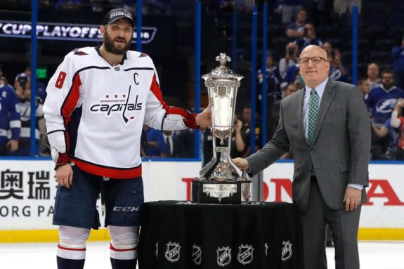Alex Ovechkin #8 of the Washington Capitals and NHL Deputy Commissioner Bill Daly
