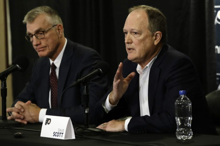 Paul Holmgren, left, and Comcast Spectacor Chairman and CEO Dave Scott