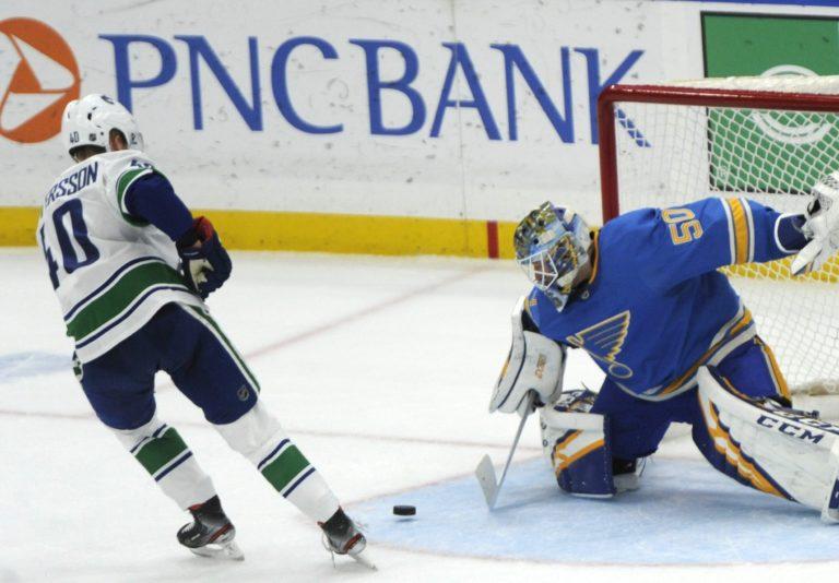 St. Louis Blues goalie Jordan Binnington Vancouver Canucks' Elias Pettersson