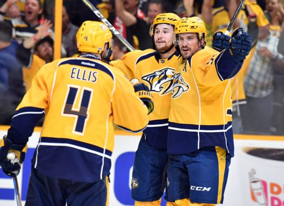 Filip Forsberg celebrates with defenseman Roman Josi, defenseman Ryan Ellis