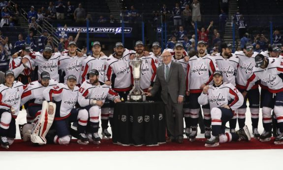 Washington Capitals players and coaches pose with the Prince of Wales Trophy