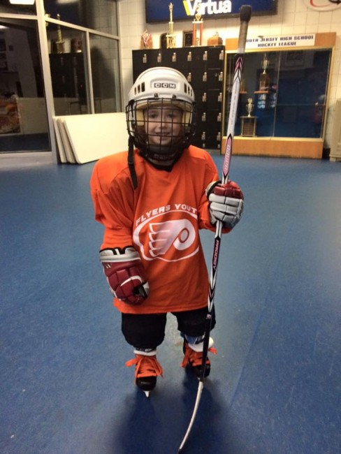 Riley, of the Flyers Youth Special Hockey Club, prepares to hit the ice! Photo courtesy of Flyers Youth Special Hockey